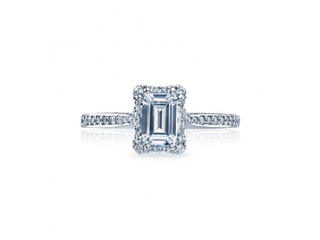 A classic look with modern flair, a crown of diamonds surrounds an emerald-cut center stone, adding depth and dimension.