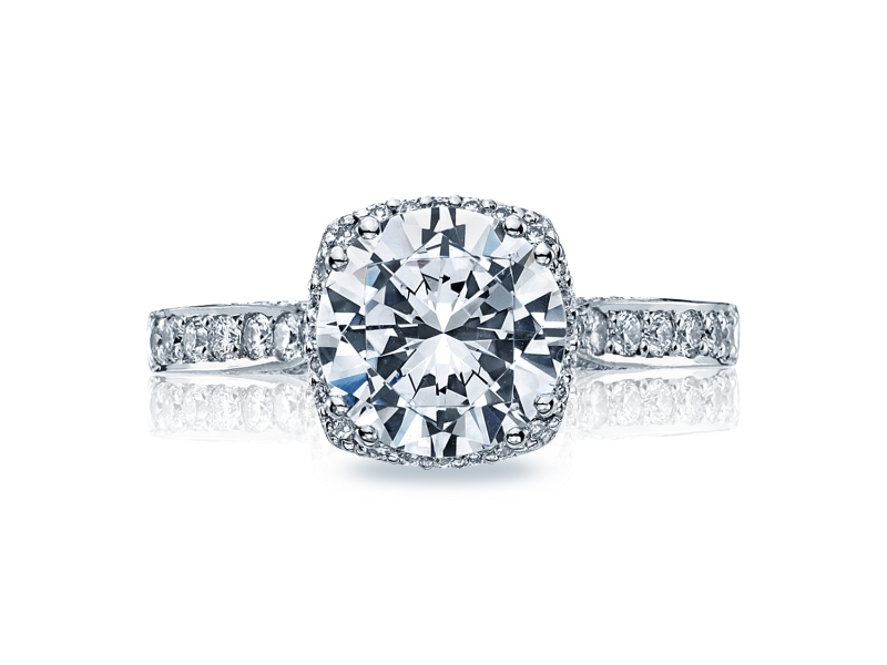 This unique setting creates a look that is a beautiful juxtaposition of modern, yet traditional; classic, yet unconventional. A stunning, diamond-surrounded round center diamond is surrounded by pavé set diamonds curving along the ceiling, with signature Tacori details along the sides for a woman with strength and sophistication.
