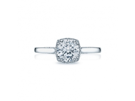 "This unique setting creates a look that is a beautiful juxtaposition of modern, yet traditional; classic, yet unconventional. High-polished platinum and a ""blooming"" crown of spotlight enhancers add depth and dimension to this stunning engagement ring."